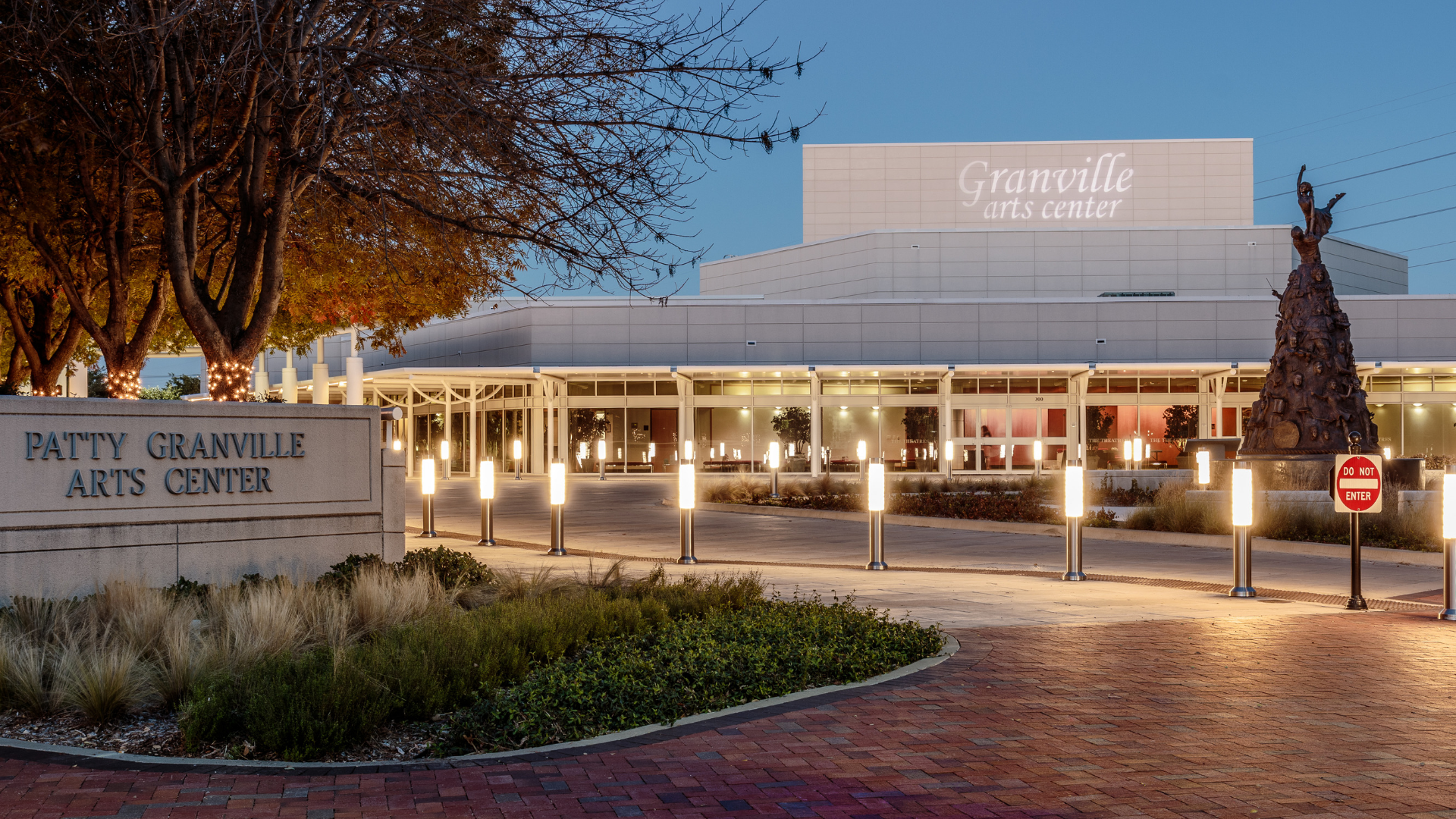 The exterior of the Granville Arts Center at dusk